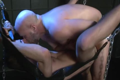 A Father hammers His Son In A Sling